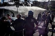 Roma 16 Ottobre 2015<br /> Un centinaio di studenti ha protestato in piazzale Aldo Moro, di fronte all'Università La Sapienza, la sede del  Maker Faire 2015, la fiera dell'innovazione europea organizzata all'interno dell'universita. I manifestanti denunciano l'uso privatistico di una struttura pubblica, l'interruzione delle attività di ricerca e la non trasparenza sull'uso dei ricavi.I manifestanti vengono colpiti dagli idranti della polizia.<br /> Rome 16 October 2015<br /> A hundred students protested in Piazzale Aldo Moro, opposite the University La Sapienza, the headquarters of the Maker Faire 2015, the European innovation fair organized within the university. Protesters denounce the  private use of a public facility, the interruption of research and lack of transparency on the use of revenues. Protesters are hit by water cannons police