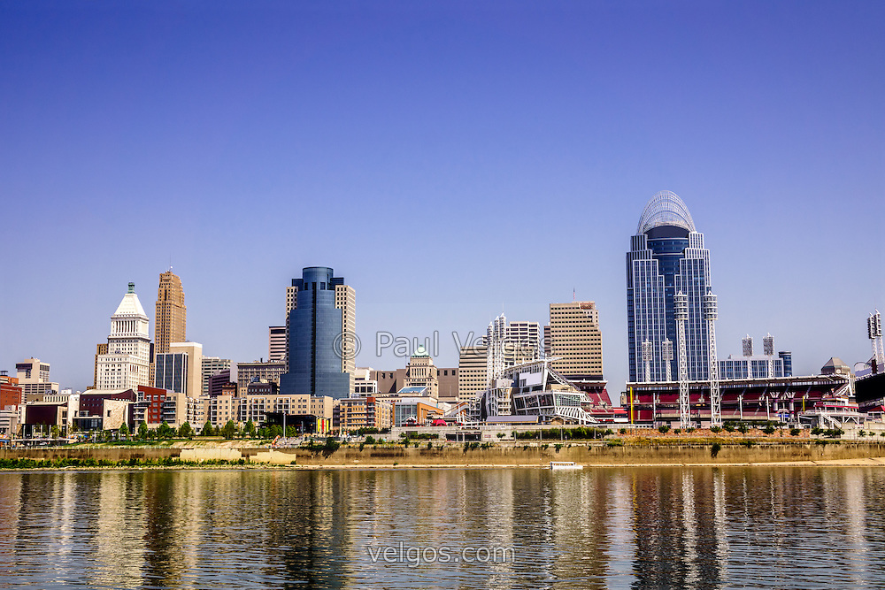Photo of Cincinnati skyline riverfront with popular downtown city buildings including Great American Ballpark, Great American Insurance Group Tower, PNC Tower building, Omnicare building, US Bank building, Carew Tower building, and Scripps Center building. Photo was taken in July 2012 and is high resolution.