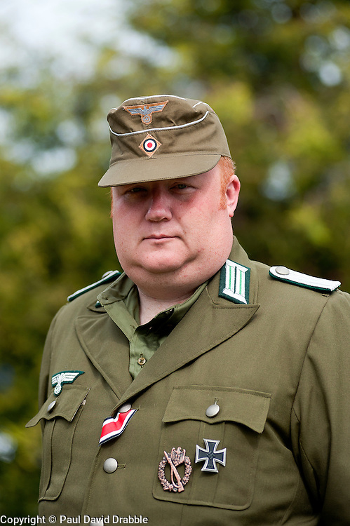 Reenactor dressed as an officer from the 21st Panzer division Afrika Korps at the Northallerton Wartime Weekend he is wearing the Iron Cross Second Class Medal Ribbon, Infantry Assault Badge and Iron Cross First class<br /> .18th and 19th June  2011<br /> Image &copy; Paul David Drabble