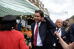 Ed Miliband East Street Market Visit. Labour leader Ed Miliband being egged by a member of public during a  living standards related visit to South East London's East Street Market.  This is Milliband's first official visit since coming back from holiday, <br /> East Street Market, London, United Kingdom. Wednesday, 14th August 2013. Picture by Andrew Parsons / i-Images