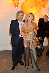 BALDASSARE LA RIZZA and YVONNE RIEBER at a private view of work by artist Dale Chihuly: Beyond the Object was held at The Halcyon Gallery 144-146 New Bond Street, London on 5th February 2014.