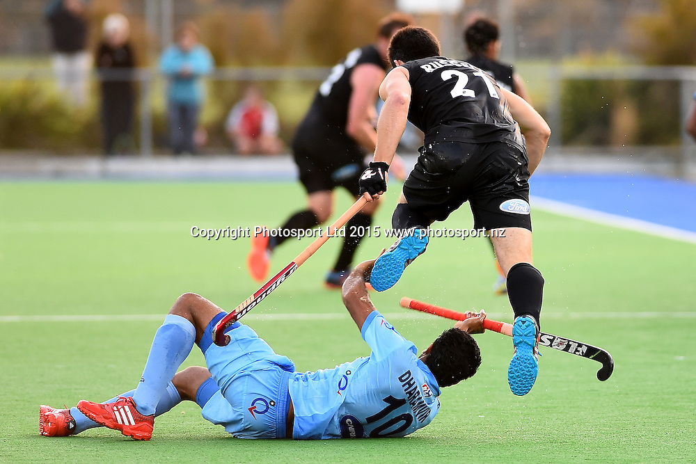 Black Sticks Men player Kane Russell leaps over Indian player Dharamvir Singh during their 2015 South Island Tour game between the New Zealand Black Sticks Men v India. Saxton Turf, Nelson, New Zealand. Tuesday 6 October 2015. Copyright Photo: Chris Symes / www.photosport.nz