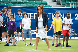 LIVERPOOL, ENGLAND - Wednesday, June 20, 2012: Liverpool City Cllr Anna Rothery trys hitting a ball on centre court during a kids' day at the Medicash Liverpool International Tennis Tournament at Calderstones Park. (Pic by David Rawcliffe/Propaganda)