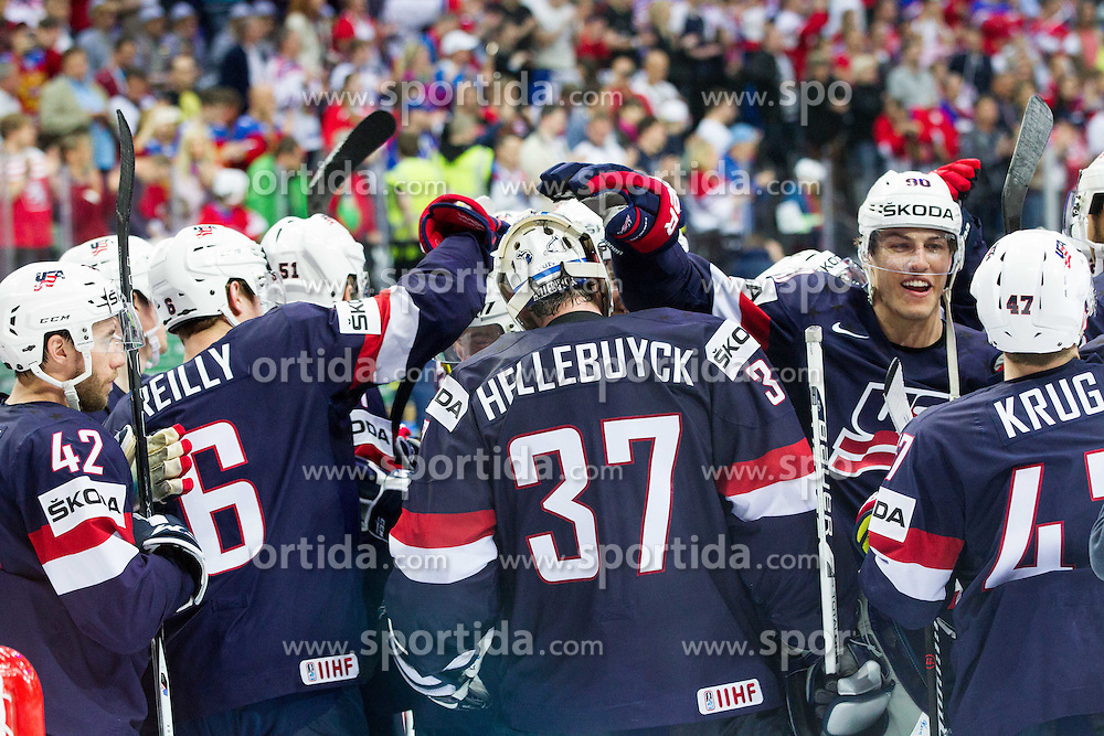 Dan Sexton of USA, Mike Reilly of USA, Connor Hellebuyck of USA and Anders Lee of USA celebrate after winning during Ice Hockey match between USA and Czech Republic at Third place game of 2015 IIHF World Championship, on May 17, 2015 in O2 Arena, Prague, Czech Republic. Photo by Vid Ponikvar / Sportida