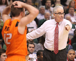 SMU head coach Matt Doherty gestures at an official during an NCAA college basketball game against Oklahoma State, in Dallas, Wednesday, Dec. 28, 2011.