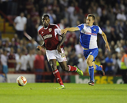 Bristol City's Jay Emmanuel-Thomas battles for the ball with Bristol Rovers' Tom Lockyer  - Photo mandatory by-line: Joe Meredith/JMP - Tel: Mobile: 07966 386802 04/09/2013 - SPORT - FOOTBALL -  Ashton Gate - Bristol - Bristol City V Bristol Rovers - Johnstone Paint Trophy - First Round - Bristol Derby