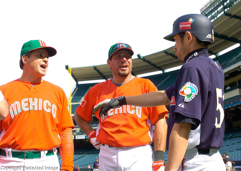 Team Japan's Ichiro Suzuki #51 chats with members of Team Mexico before the start of the game in Round 2 action at Angel Stadium of Anaheim.