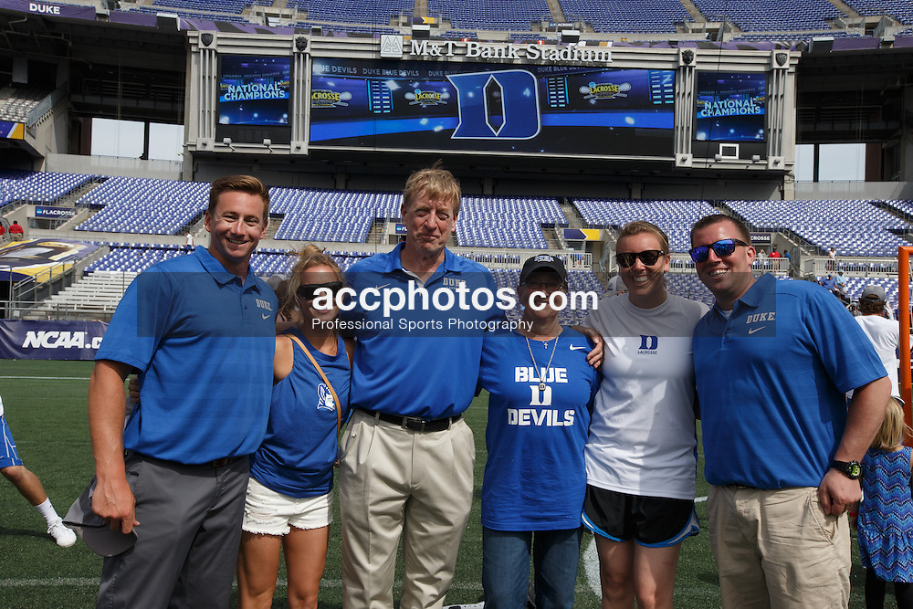 2014 May 26: Assistant coach Matt Danowski and head coach John Danowki of the Duke Blue Devils with wife Tricia Danowski and children after a win over the Notre Dame Fighting Irish to win the NCAA championship at M&T Bank Stadium in Baltimore, MD.