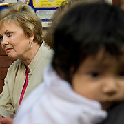 Representative Kay Granger listens to women speak about their pregnancies during CARE's Learning Tour visit to the San Cosme Health Center. San Cosme is a slum in Lima that has the highest rate of tuberculosis in Lima, but has limited health services for the community. The Global Fund is supporting services in San Cosme's health center.