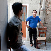 Riace, Calabria, Italia, aug. 2010. Refugees received in Riace. Riace il paese che accoglie rifugiati. Dawud (Afghanistan) and the Riace's mayor, Domenico Lucano.