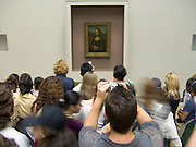 Crowd taking pictures of the Mona Lisa Musee du Louvre Paris