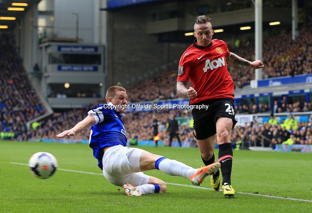20th April 2014 - Barclays Premier League - Everton v Manchester United - James McCarthy of Everton tackles Alexander Buttner of Man Utd - Photo: Simon Stacpoole / Offside.