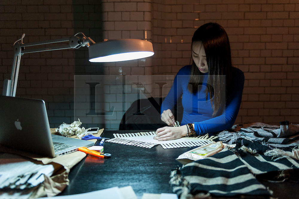 © Licensed to London News Pictures. 17/02/2016. London, UK. Chiayun Hu works on her designs at the London College of Fashion MA16 exhibition in Holborn which opened today.  The event features student work from across LCF's postgraduate courses and reveals visions and pieces from the next generation of fashion designers, artists, business professionals and media makers.. Photo credit : Stephen Chung/LNP