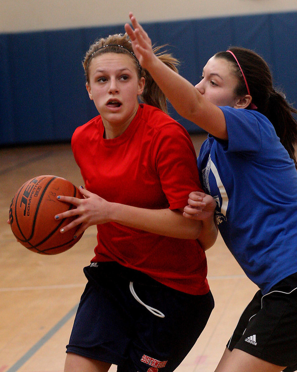 Southwestern's Syd Burke drives the ball toward the basket during middle school basketball playoff action against Jamestown at the GA home in the Tom Buffafaro Y league 3-2-13 photo by Mark L. Anderson