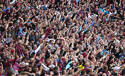 Aston Villa fans celebrate their side's second goal of the game, scored by player John McGinn (not pictured)