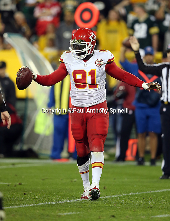 Kansas City Chiefs outside linebacker Tamba Hali (91) waves his arms and the ball as he celebrates after recovering a second quarter fumble on a quarterback sack (a penalty negated the turnover) during the 2015 NFL week 3 regular season football game against the Green Bay Packers on Monday, Sept. 28, 2015 in Green Bay, Wis. The Packers won the game 38-28. (©Paul Anthony Spinelli)