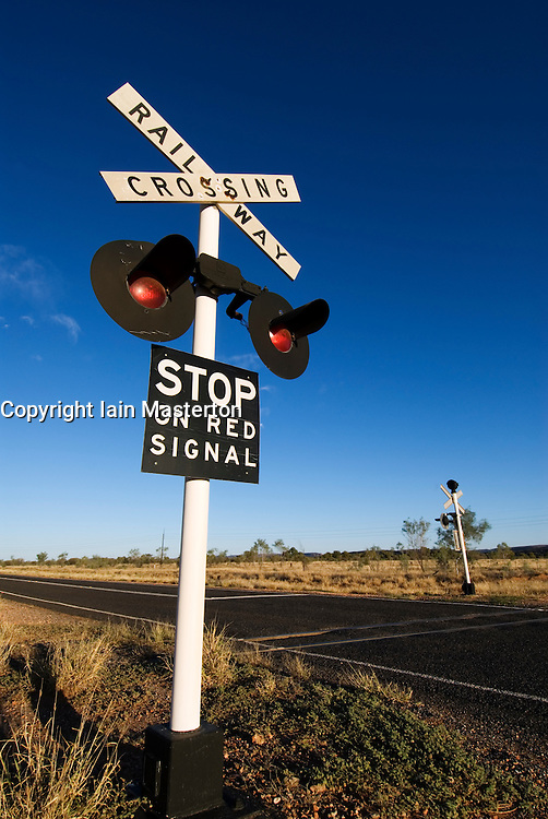 Railway crossing sign on highway in Outback Australia