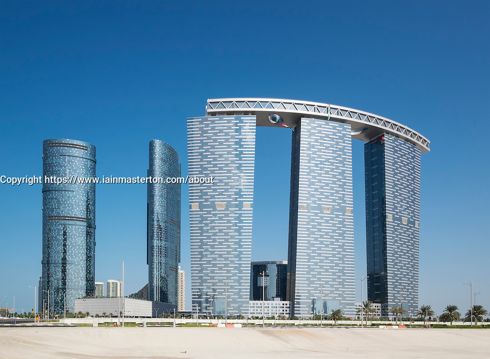 Modern high-rise residential and office buildings, with Gate Tower on right, under construction on Al Reem Island in Abu Dhabi United Arab Emirates
