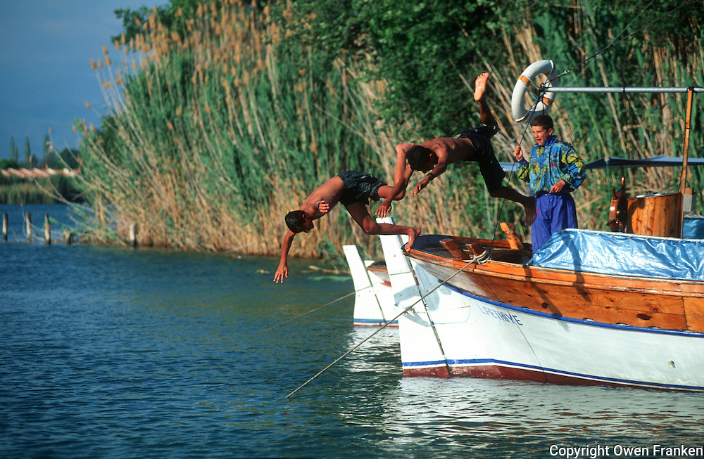 boys jumping from a boat in Daylan, Turkey..© Owen Franken