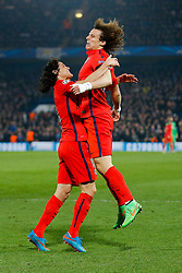 Edinson Cavani and David Luiz of Paris Saint-Germain celebrate after Thiago Silva scores a goal to make it 2-2 - Photo mandatory by-line: Rogan Thomson/JMP - 07966 386802 - 11/03/2015 - SPORT - FOOTBALL - London, England - Stamford Bridge - Chelsea v Paris Saint-Germain - UEFA Champions League Round of 16 Second Leg.