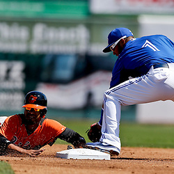 Mar 5, 2013; Dunedin, FL, USA; Baltimore Orioles baserunner Alexi Casilla is forced out in a double play by Toronto Blue Jays second baseman Emilio Bonifacio (1) during the top of the first inning of a spring training game at Florida Auto Exchange Park. Mandatory Credit: Derick E. Hingle-USA TODAY Sports