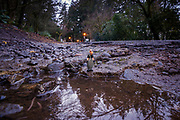 A mini-series following my 44mm-high Homies character Pelon, where he poses for photo ops at potholes on the streets of Mount Tabor Park.<br /> Leadership fixes potholes, not patching.<br /> Chronic neglect of Portland's streets is manifesting in the burgeoning number and size of dangerously large potholes across the city.  Here, pothole road damage is seen in Mount Tabor Park, Portland, Oregon. <br /> Engineering: From a technical perspective, a great deal of information can be gleaned from a deep pothole, as it provides a cross-section-view of the pavement structural section…or lack thereof, as in this case.  Here, the asphalt wearing surface is heavily pitted, highly oxidized and brittle, confirming many years of neglect.  The asphalt layer is minimal; confirming this road never received the maintenance originally planned. The river-rounded pebbles of the base course layer tell the story of a roadway constructed originally from deficient materials. Roadway base course should be well-graded, faceted aggregate so as to provide optimum particle interlock – a crushed and sieved mix from those same pebbles would suffice.  Pelon is standing on concrete – evidence of a previous attempt to effect a repair – but that repair effort was doomed to fair because it was placed too thin, and was never going to be waterproof.  Poor drainage has contributed to the failure of this road.  The conclusion is unequivocal; this road has failed and no amount of patching will restore a level of service – or service life – that should be reasonably expected of it.<br /> #portlandpotholes #PortlandOregon #MtTaborPark #potholes #neglect #deferredmaintenance #fail #safety #politics #civilengineering