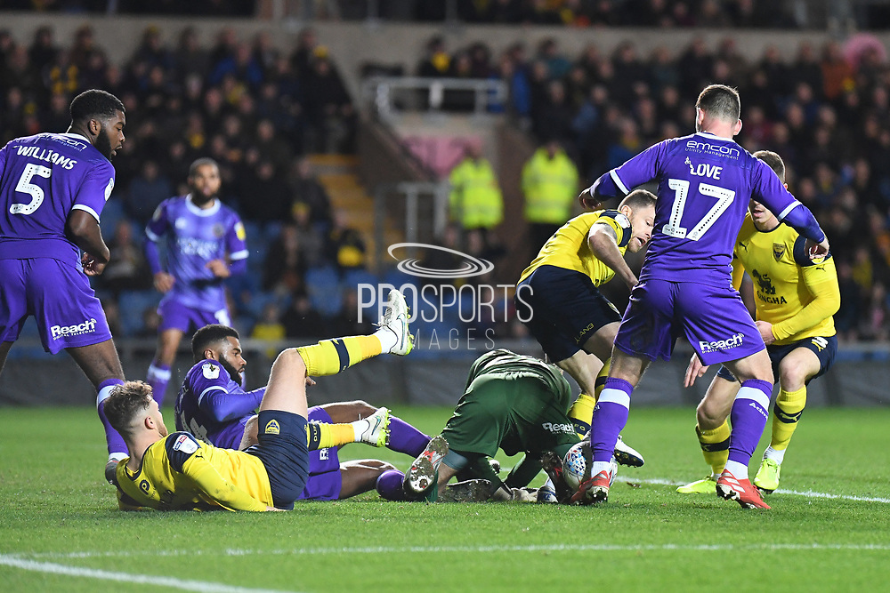 Oxford United forward Jamie Mackie (19) battles for possession  with Shrewsbury Town defender goalkeeper (on loan from Bristol City) Max O'Leary (25) during the EFL Sky Bet League 1 match between Oxford United and Shrewsbury Town at the Kassam Stadium, Oxford, England on 7 December 2019.