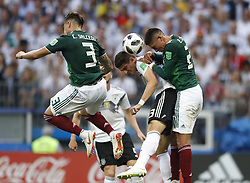 MOSCOW, June 17, 2018  Mario Gomez (2nd R) of Germany vies with Edson Alvarez (1st R) of Mexico during a group F match between Germany and Mexico at the 2018 FIFA World Cup in Moscow, Russia, June 17, 2018. Mexico won 1-0. (Credit Image: © Cao Can/Xinhua via ZUMA Wire)