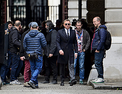 "© Licensed to London News Pictures. 30/05/2015. London, UK. . Filming for the new James Bond film ""Spector"" with Daniel Craig (pictured centre) and Naomie Harris (not pictured) at the courtyard of the UK Government Treasury building in Westminster, London . Photo credit: Ben Cawthra/LNP"