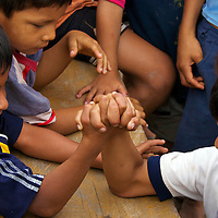 This photograph of children arm wrestling was taken in a Amazon rainforest village in the Pacaya-Samiria National Reserve section of the Amazon rainforest in Peru.  The Pacaya-Samiria National Reserve is the second largest protected area in the Amazon region.