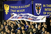 AFC Wimbledon fans with banner during the EFL Sky Bet League 1 match between AFC Wimbledon and Milton Keynes Dons at the Cherry Red Records Stadium, Kingston, England on 22 September 2017. Photo by Matthew Redman.