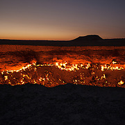 A view into the Darwaza gas crater at sunrise, Karakum Desert, Turkmenistan