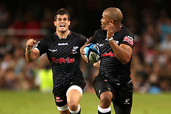 JP Pietersen runs in the try to seal the win for the Sharks during the Super15 match between The Mr Price Sharks and The Blues held at Mr Price Kings Park Stadium in Durban on the 26th February 2011..Photo By:  Ron Gaunt/SPORTZPICS