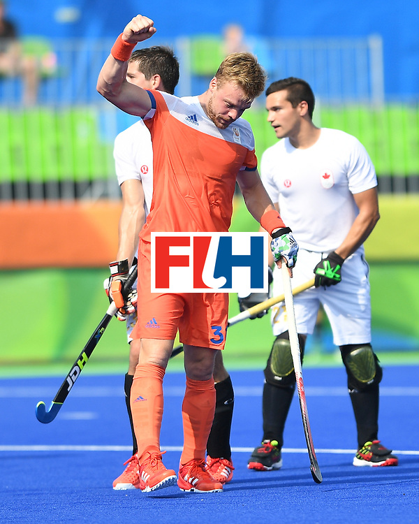 Netherland's Mink van der Weerden (C) celebrates scoring a goal during the men's field hockey Netherlands vs Canada match of the Rio 2016 Olympics Games at the Olympic Hockey Centre in Rio de Janeiro on August, 9 2016. / AFP / MANAN VATSYAYANA        (Photo credit should read MANAN VATSYAYANA/AFP/Getty Images)
