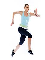 one beautiful caucasian woman running run runner sprinting on studio white isolated background