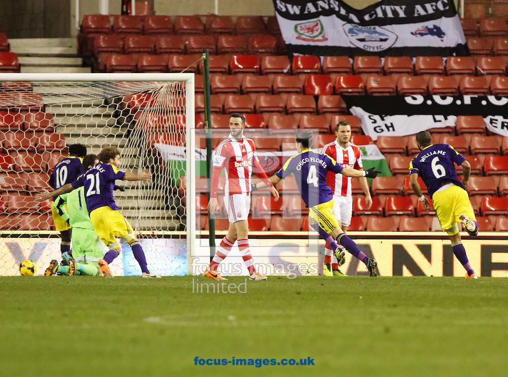 Chico (3rd right) of Swansea City celebrates scoring his sides first goal during the Barclays Premier League match at the Britannia Stadium, Stoke-on-Trent<br /> Picture by Tom Smith/Focus Images Ltd 07545141164<br /> 12/02/2014