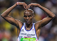 Mo Farah of Great Britain takes Gold to retain his title in the Men's 10,000m on day eight of the XXXI 2016 Olympic Summer Games in Rio de Janeiro, Brazil.<br /> Picture by EXPA Pictures/Focus Images Ltd 07814482222<br /> 13/08/2016<br /> *** UK & IRELAND ONLY ***<br /> <br /> EXPA-GRO-160814-5310.jpg