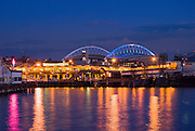 Qwest Field and shops along the waterfront at dusk, Seattle, Washington