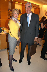 RUPERT & ROBYN HAMBRO at a party to celebrate the publication of 'Made for Maharajas' by Dr Amin Jaffer hosted by Louis Vuitton at their store on Sloane Street, London on 10th October 2006.<br />