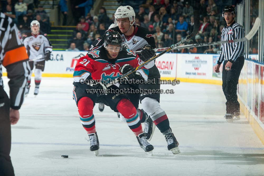 KELOWNA, CANADA - NOVEMBER 11: Radovan Bondra #41 of Vancouver Giants back checks Devante Stephens #21 of Kelowna Rockets as he skates with the puck during first period on November 11, 2015 at Prospera Place in Kelowna, British Columbia, Canada.  (Photo by Marissa Baecker/Getty Images)  *** Local Caption *** Radovan Bondra; Devante Stephens;