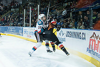 KELOWNA, CANADA - FEBRUARY 28: Leon Draisaitl #29 of Kelowna Rockets checks a player of the Calgary Hitmen into the boards on February 28, 2015 at Prospera Place in Kelowna, British Columbia, Canada.  (Photo by Marissa Baecker/Shoot the Breeze)  *** Local Caption *** Leon Draisaitl;