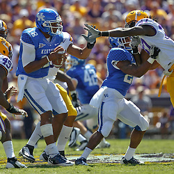 October 1, 2011; Baton Rouge, LA, USA;  LSU Tigers defenders defensive end Barkevious Mingo (49), defensive end Kendrick Adams (94) and linebacker Karnell Hatcher (37) pressure Kentucky Wildcats quarterback Morgan Newton (12) during the second quarter at Tiger Stadium.  Mandatory Credit: Derick E. Hingle-US PRESSWIRE / © Derick E. Hingle 2011