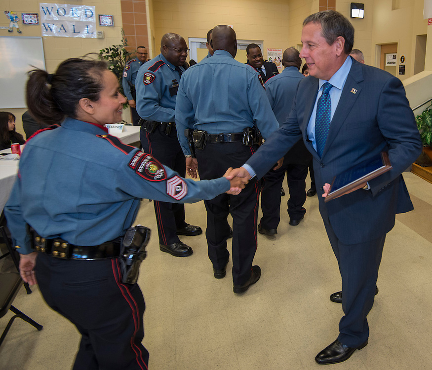 Chief Robert Mock, right, congratulates members of the Power Shift / Elementary Rover team after they received the Unit Citation of the Year award from during the Houston ISD Police awards banquet at Thompson Elementary School, August 15, 2014.