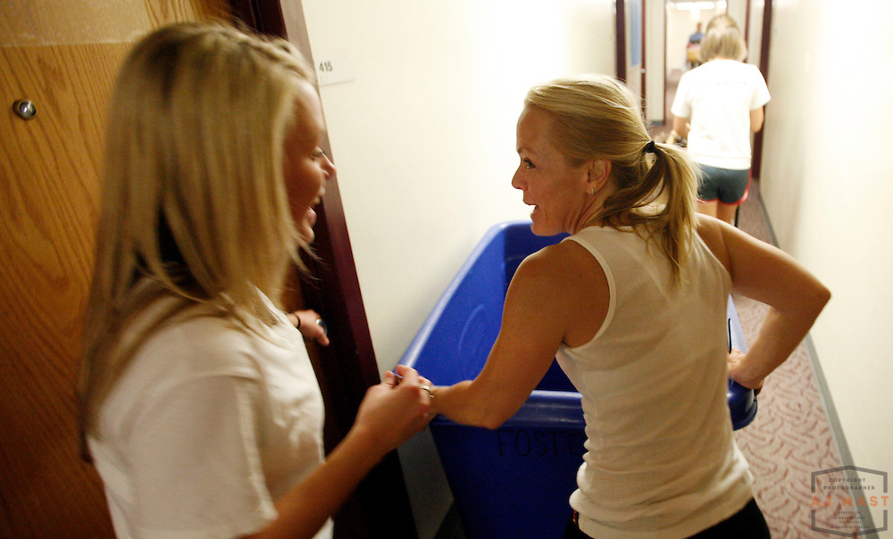 Logan Ronk, left, of Cincinnati, has a laugh with her mother Kim Ronk while moving into her dorm at Indiana University in Bloomington, Ind., Wednesday, Aug. 27, 2008.  ( Photo by AJ Mast)
