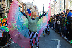 London, March 13th 2016. The annual St Patrick's Day Parade takes place in the Capital with various groups from the Irish community as well as contingents from other ethnicities taking part in a procession from Green Park to Trafalgar Square.  PICTURED: An inline skater flares her &quot;wings&quot; during the procession. &copy;Paul Davey<br /> FOR LICENCING CONTACT: Paul Davey +44 (0) 7966 016 296 paul@pauldaveycreative.co.uk