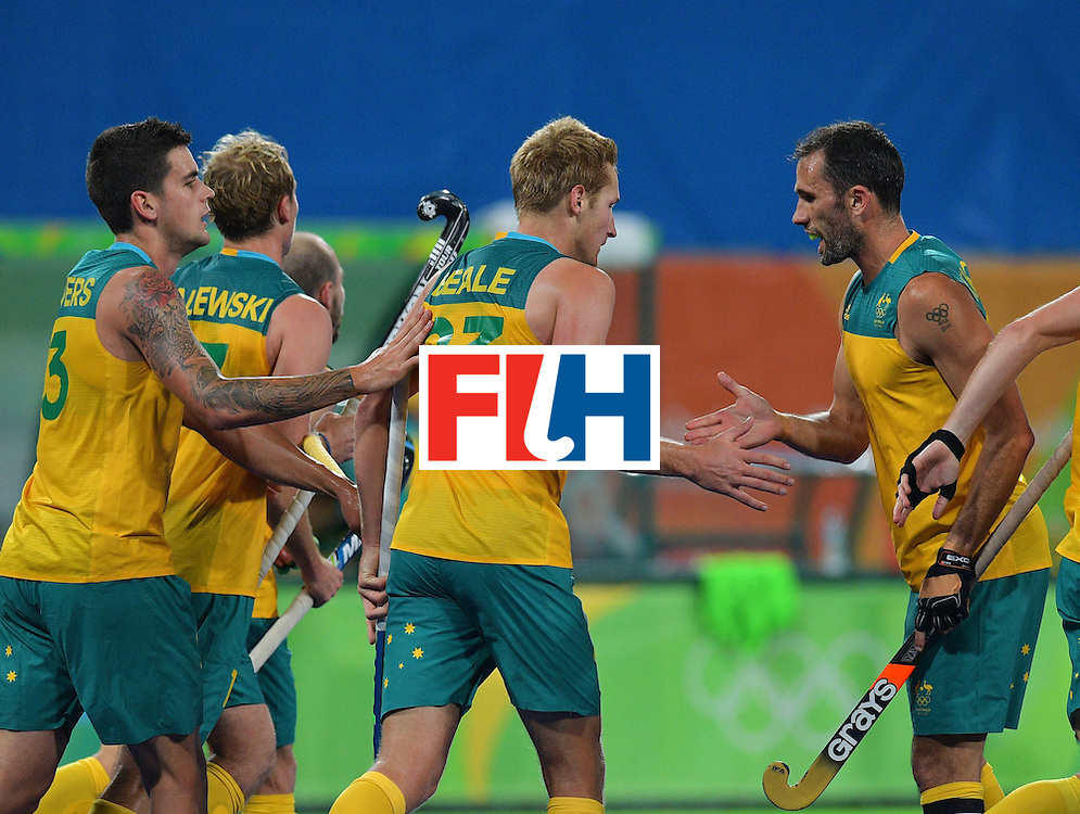 Australia's Daniel Beale (C) celebrates a goal with teammate Mark Knowles (R) during the men's field hockey Britain vs Australia match of the Rio 2016 Olympics Games at the Olympic Hockey Centre in Rio de Janeiro on August, 10 2016. / AFP / Carl DE SOUZA        (Photo credit should read CARL DE SOUZA/AFP/Getty Images)
