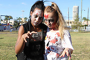 "Two HSPVA students show off their zombie looks before performing in a ""Thriller"" flash mob outside the Metropolitan Multi-Services Center, where early voting was being held.<br />
