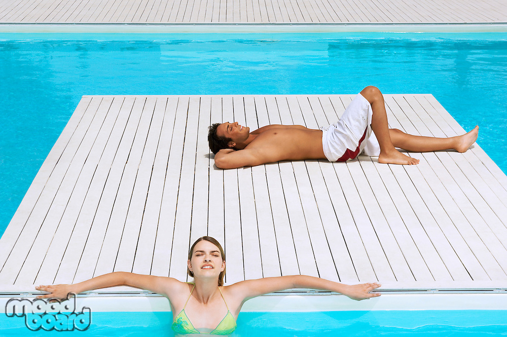 Couple Relaxing at Swimming Pool high angle view