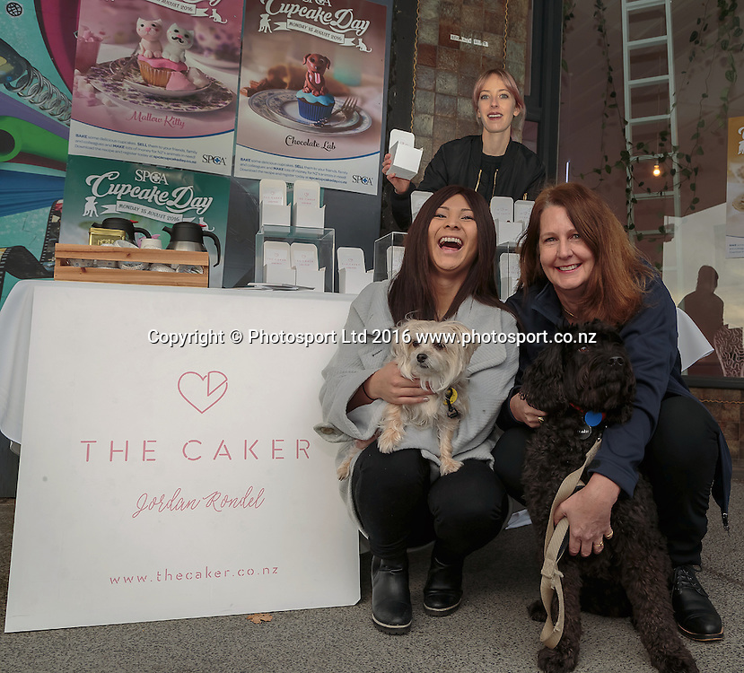 20160803 SPCA Cupcakes. Publicity photo for the SPCA cupcake day, Lillian Cheh, SPCA Auckland Events Assistant, and her dog Mwaji, Bridget Vercoe, Communications and engagement SPCA NZ, and her dog Frankie photographed at The Cakery, Karangahape Road, Auckland in advance of the fund raising day Monday August 15th 2016. Photo: David Mackay / www.photosport.nz