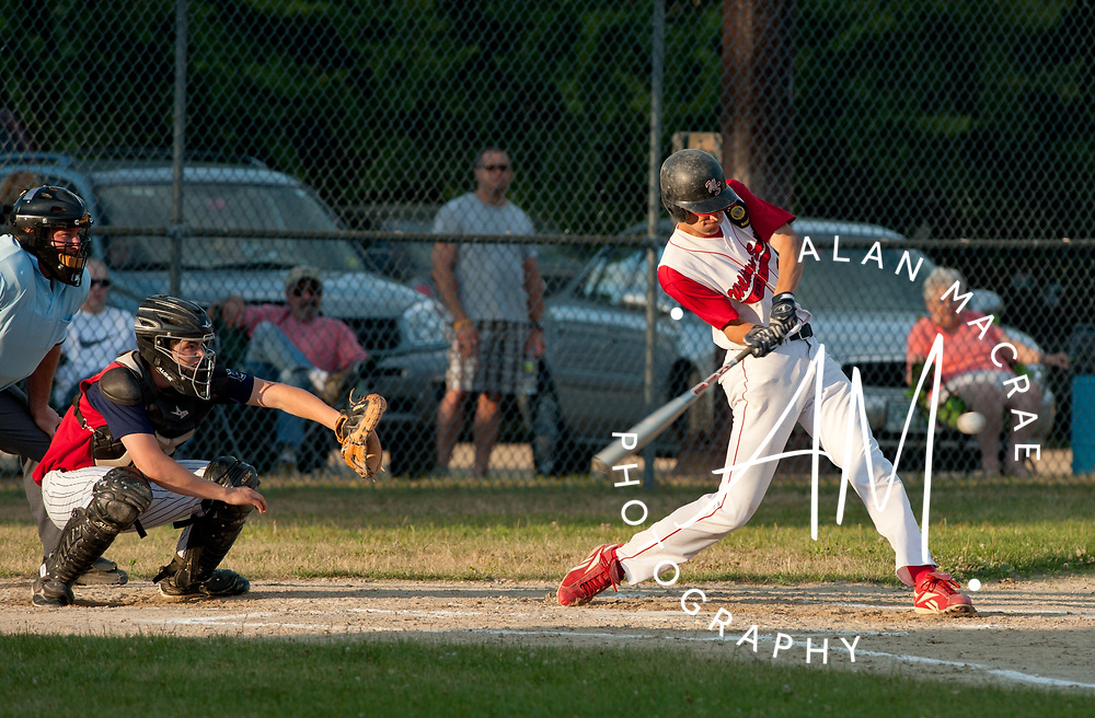 Post 1's Derrick Sylvester rips a shot during Friday's game against Sweeney Post 2 at Laconia's Memorial Park.  (Alan MacRae/for the Citizen)
